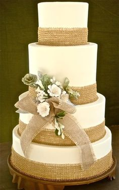 Wedding cake with burlap at the edges. Very pretty for an outdoor or country themed wedding. ᘡղᘠ weddingcakesbyjimsmeal.com cake decorating ideas