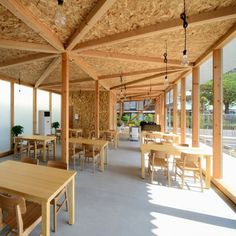 Japanese cafeteria with exposed timber framework by Niji Architects