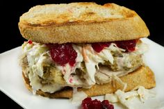 Day After Thanksgiving Turkey Sandwich on a good sour dough bread toasted, with mayo, stuffing, sliced turkey, whole berry cranberry sauce, and of course cole slaw!