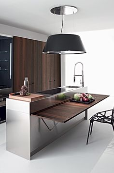 *studio kitchen What about a folding table top for flexible use of space?