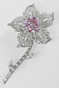 CARTIER Famous pink diamonds include The Williamson Pink, a superlative solitaire pink diamond at the centre of a flower spray brooch created by Cartier in 1953 to celebrate Her Majesty the Queen's coronation. Another famous piece is a suite of koalas from Graff, clearly linking these iconic gems to their Australian source