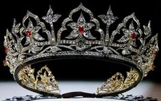Designed by Prince Albert and made by Garrard for Queen Victoria in 1853, this tiara was originally set with opals. They were switched to rubies by Queen Alexandra as the tiara began to pass from queen to queen. It was frequently worn by the Queen Mother, and passed to the Queen on her death in 2002. The Queen has only worn it once to date.