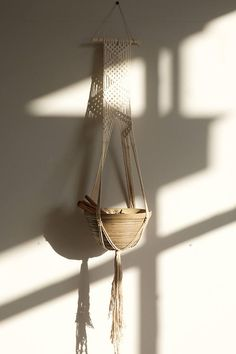 This macrame plant hanger is a fun way to display your plants and give some character to your space :) This unique plant holder was handmade by me in Barcelona. This plant hanger is approximately 125cm long. It can accommodate one big bowl. The hanger is made with natural cotton cord and