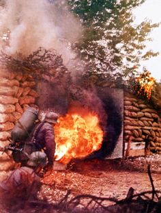 Operation Barbarossa Two Wehrmacht soldiers are attacking a bunker with a flamethrower on the Eastern Front in Russia, 1941.