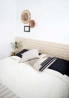 DIY Wood Slat Headboard - The Merrythought wood headboard DIY Wood Slat Headboard Faux Headboard, White Headboard, Headboards For Beds, Scandinavian Bedding, Bed Slats, White Rooms, Diy Bed, Home Bedroom, Bed Frame