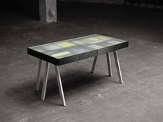 The Treasury Table, designed by Lucie Koldová for Process, looks like an ordinary table but under the top hides secret compartments for just about anything