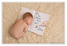 New Born Baby Photography Picture Description Tiffany Walensky Photography, Tampa FL newborn photographer, valrico newborn photography, baby boy infant profile studio lighting pose posing posed creative fun modern colorful ivory flokati ideas props book dr seuss whimsical reading bookworm