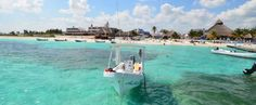 Puerto Morelos is a small fishing village between Playa del Carmen and Cancun that has a lot of activities including cenotes, snorkeling and over 80 restaurants for dining.