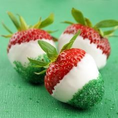 Dip strawberries into melted white chocolate (or vanilla candy melts) & then roll end into green sugar.