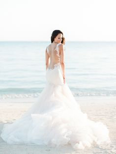 Stunning wedding dress: Photography: Ether & Smith - www.etherandsmith.com   Read More on SMP: http://www.stylemepretty.com/2016/08/24/white-color-palette-jamaica-destination-wedding/