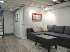 Painting Basement Ceiling White. Cozy Chic Basement Reno With Exposed Painted Joists Wood Tile Floors