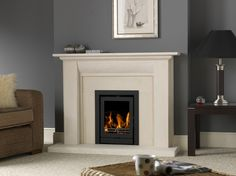 The Stokesay is a stylish limestone fireplace that will look great in any home. This modern looking limestone surround will make a great center point in your living room. This fireplace is one of the shortest on the fireline range which makes it perfec Log Burner Fireplace, Limestone Fireplace, Wood Fireplace, Wood Burner, Fireplace Design, Fireplace Ideas, Inset Log Burners, Inset Stoves, Wood Burning Fires