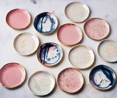 Modern handmade ceramics by Lindsay Emery. Porcelain and stoneware with colorful watercolor glazes and gold accents, rims, and splatters. Artisan pottery made in Greensboro North Carolina in small batches and limited editions. Ceramic Plates, Ceramic Pottery, Ceramic Art, Ceramic Coasters, Keramik Design, Deco Originale, Happy Kitchen, Ideias Diy, Ring Dish