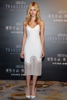 Nicola Peltz made an appearance at a Hong Kong press conference in a simple Stella McCartney dress from the designer's recent pre-fall collection. [Photo by ChinaFotoPress/Getty Images]