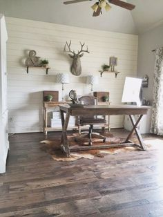 Love This Gorgeous Rustic Home Office! The Shiplap Walls Are Gorgeous! You Want This Room For Your House! The Rug And Deer Head Are Fun Touches! @Remodelaholic