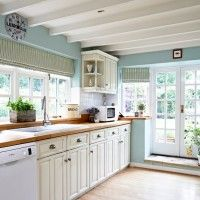 Ice blue country kitchen with cream cabinetry