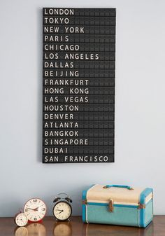 First you buy this 'All Aboard Departure' sign reminiscent of Grand Central Station, then you make a point of traveling to the destinations listed. Think of it as an artistic to-do list!