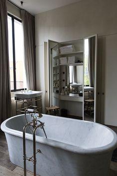 A make-up vanity with mirrors, built-in and hidden behind closet doors. Apartment Graanmarkt 13 in Antwerp I Remodelista