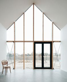 floor to ceiling windows. interesting as the frame is wood. For the lookout the glazing needs to be  split into smaller sections, but I like the narrow but deep timber frame on this.