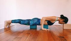 Chaturanga Dandasana is one of the most difficult arm balances out there, even with the support of both feet on the ground. This setup takes advantage of the wall and three blocks to keep the body light and anterior deltoid and rotator cuff muscles safe. Pla