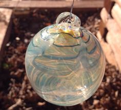 A personal favorite from my Etsy shop https://www.etsy.com/listing/258208128/handmade-glass-ball-hanging