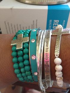 bracelets. Love the teal with the cross.