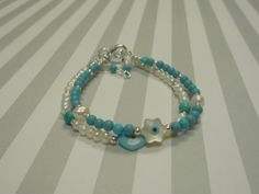 Turquoise and White Freshwater Pearls Evil Eye by urbaneprincess, $15.00