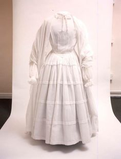 Replica of Charlotte's lost wedding dress from written descriptions