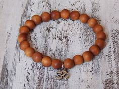 This fragrant bracelet is simple, but fashionable. Aromatic #sandalwood beads are perfect for any stressful day. Complemented with a single pewter OM.   Wear this alone or w... #meditation
