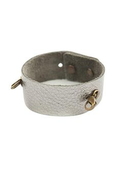 "Made from the finest leathers, these classic cuffs go great with any style. A bit vintage, a bit rock & roll, a bit urban, but 100% Lenny & Eva. Cuffs can be worn with our interchangeable sentiments and pendants. All cuffs are made of genuine leather. Adjustable buttonhole closure.    Fits wrists 6"" x 8"" x 1"" wide.   Gunmetal Thin Cuff by Lenny & Eva. Accessories - Jewelry - Bracelets Missouri"