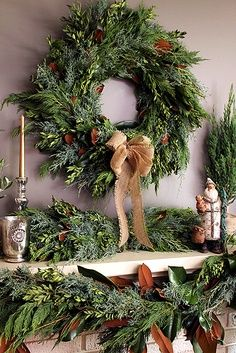 Beautiful wreath and greenery-Resources needed: -Evergreen branches -Pinecones -Burlap ribbon -Ribbon  -Leaves -Brighten up your mantle!
