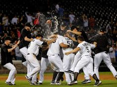 The Chicago White Sox celebrate after Avisail Garcia #26 hit a walkoff one run RBI double against the Los Angeles Angels of Anaheim at U.S. Cellular Field on August 12, 2015 in Chicago, Illinois. The Chicago White Sox won 3-2 in thirteen innings. - © Jon Durr, Getty Images