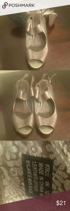 Copper colored Indigo open toe shoes Cooper colored Indigo brand shoes.  Super comfortable,  leather upper,  open toe shoes. Indigo by Clark  Shoes Sandals