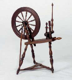 A STAINED OAK SPINNING WHEEL,   19TH/20TH CENTURY,   distressed   38½in. (98cm.) high, 33in. (84cm.) long