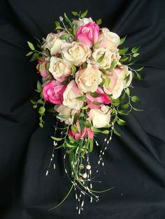 another DIY bouquet.. this site is awesome! has a list of supplies needed, pricing, plus a video how-to for a cascading bouquet. #weddingflowers