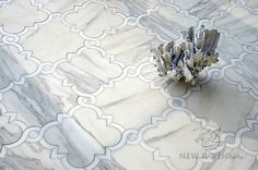 Atticus, a stone waterjet mosaic, shown in honed Calacatta, polished Thassos, and Shell | Parterre Collection | Sara Baldwin Designs for New Ravenna