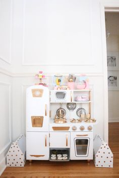 Just like so many, we fell for this KidKraft Vintage Kitchen HERE. You can't beat the price, the size and just how cute it is. I came across some other mom's that had painted their kitchens or added some marble contact paper to the counter top....(which I might do)