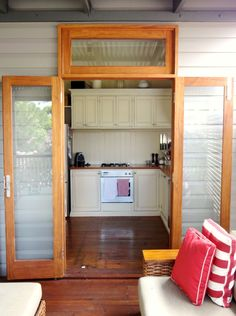 Fixed-glass window above timber French doors. www.Allkind.com.au