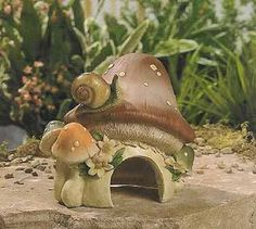 """Mushroom Frog Toad House Garden Yard Decor by OTC. $14.99. Resin. 6 1/2""""H x 6""""W. Frog House. Invite frogs to stay a while when your place this charming resin frog house in your garden. Its mushroom-shaped design is already a favorite for the snail perched on top. 6 1/2""""H x 6""""W."""