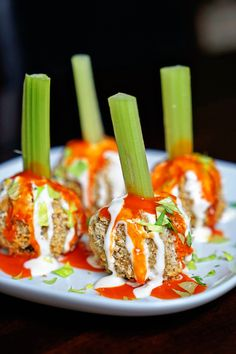 These Buffalo Chicken Meatballs get a crunchy exterior from Panko breadcrumbs and are drizzled with a bleu cheese dressing with hot sauce. Skewered with celery to serve as appetizers.