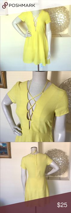 """F21 Yellow Deep V Criss Cross Lace Up Dress F21 Yellow Deep V Criss Cross Lace Up Dress. Fully lined. 35"""" shoulder to hem. Rayon/Polyester mix. Full zip in back.  REPOSH, bought to wear for an event in May but ended up being too big for me! I would say this runs larger than a true F21 medium. 💰Price is firm and reflects what I paid with posh fees💰 Forever 21 Dresses"""