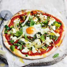 A vegetarian pizza recipe combining a perfect marriage of goat's cheese, green vegetables, fresh mint and egg – perfect for a midweek meal.