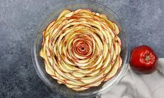 Wow your guests with this gorgeous and delicious Cinnamon Roll Apple Rose Tart. It's so easy to make and are perfect for any party. Made with fresh apples. All you need is only 5 simple ingredients: cinnamon roll dough, red apples, lemon juice, brown sugar and butter. So beautiful! Quick and easy recipe. Vegetarian.