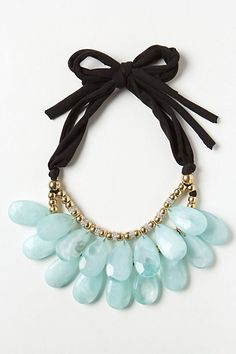 Light blue necklace.