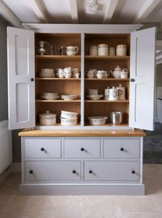 hand painted housekeepers cupboard in Farrow & Ball Pavillion Grey. Specification: natural oak surface patine cupboard knobs ash dovetailed drawer boxes traditional cornice torus skirting tounge and grooved end panels. H x D x W Cheshire Furniture Company Kitchen Dresser, Kitchen Paint, Kitchen Furniture, New Kitchen, Kitchen Cabinets, Furniture Stores, Grey Cupboards, Furniture Outlet, Kitchen Grey