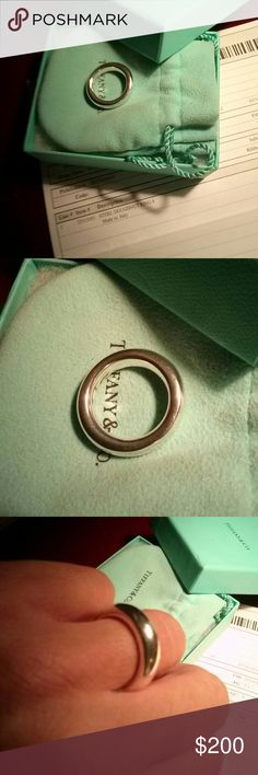 """Tiffany doughnut ring, with packaging and receipt Elsa Perreti design, feels so good to wear, smooth and heavy. Size 6. Only 1 year old and worn only a few times. Everything pictured included with full asking price. Poshmark will authenticate purchases over $500, so if you buy several of my T&Co. pieces, I can make a new listing, and sell as a """"set"""", so you can get free shipping and authentication. Tiffany & Co. Jewelry Rings"""