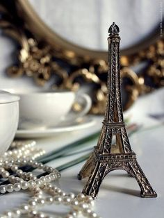 Eiffel Tower souvenir and pearls