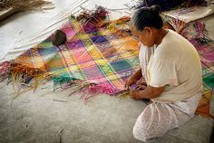 A Banig is a handwoven mat traditionally used in Philippines for sleeping and sitting. The mat is made of buri (palm), pandan or sea grass leaves. The leaves are dried, usually dyed, then cut into strips and woven into mats, which may be plain or intricate.