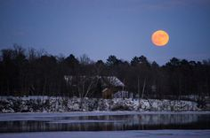 Christmas Eve moon (astronomy snow sky trees water nighttime ). Photo by jjulian