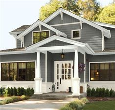 Look at the paint color combination I created with Benjamin Moore. Via Main Siding: Deep Creek Trim: Sag Harbor Gray Accent: Gloucester Sage Door: Midsummer Night Exterior Gray Paint, White Exterior Houses, Exterior Color Schemes, Exterior Paint Colors For House, Paint Colors For Home, Grey Homes Exterior, Home Exterior Design, Home Exteriors, Beige House Exterior